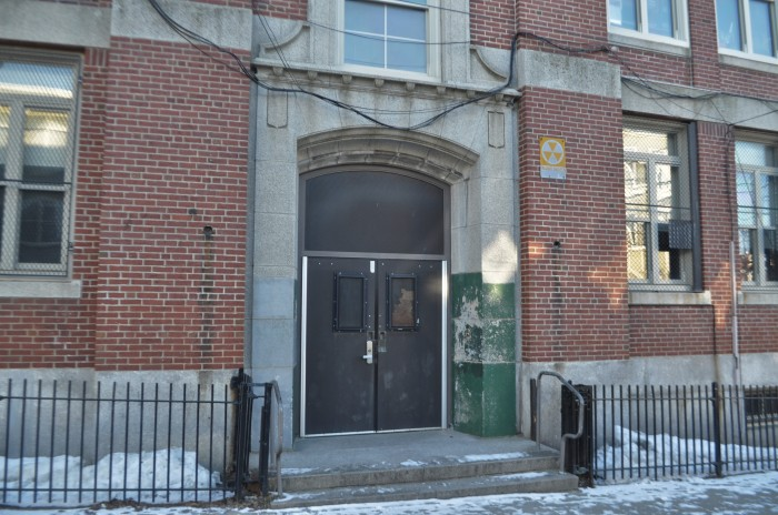 Up Academy/Patrick Gavin School-Exterior Fallout Shelter sign 2 on E 7th Street