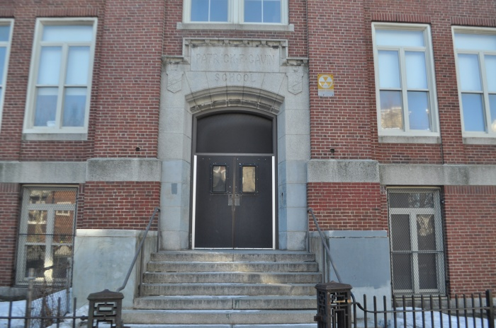 Up Academy/Patrick Gavin School-Exterior Fallout Shelter sign on E 7th Street